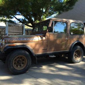 1979 Jeep CJ7 Golden Eagle   I still got Champ.  78,213 original miles on the AMC 304/TH400/Quadratrac.